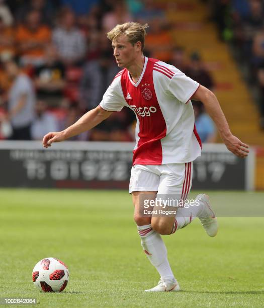 Frenkie de Jong of Ajax breaks with the ball during the pre seaon friendly match between Wolverhampton Wanderers and Ajax at the Banks' Stadium on...