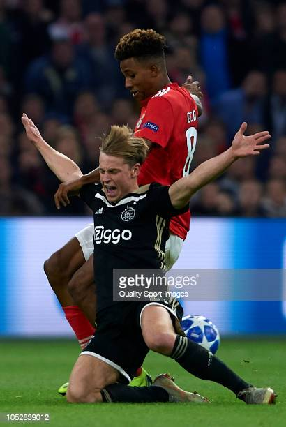 Frenkie de Jong of Ajax competes for the ball with Gedson Fernandes of Benfica during the Group E match of the UEFA Champions League between Ajax and...