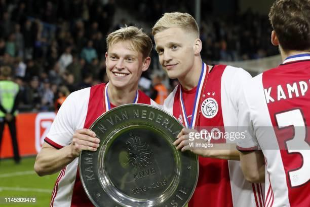 Frenkie de Jong of Ajax Donny van de Beek of Ajax with the Dutch Eredivisie trophy dish during the Dutch Eredivisie match between De Graafschap...