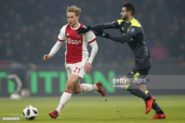 Frenkie de Jong of Ajax Gaston Pereiro of PSV during the Dutch Eredivisie match between Ajax Amsterdam and PSV Eindhoven at the Amsterdam Arena on...