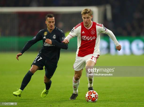 Frenkie de Jong of Ajax is challenged by Lucas Vazquez of Real Madrid during the UEFA Champions League Round of 16 First Leg match between Ajax and...