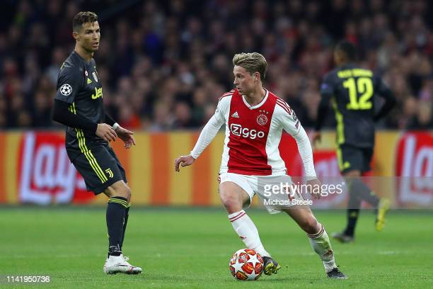 Frenkie de Jong of Ajax is tracked by Cristiano Ronaldo of Juventus during the UEFA Champions League Quarter Final first leg match between Ajax and...