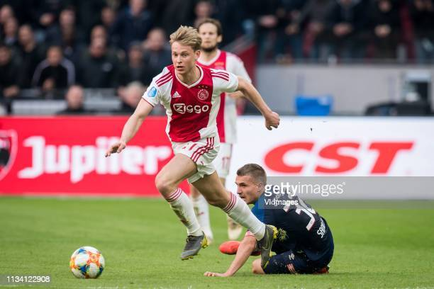 Frenkie de Jong of Ajax Michal Sadilek of PSV during the Dutch Eredivisie match between Ajax Amsterdam and PSV Eindhoven at the Johan Cruijff Arena...