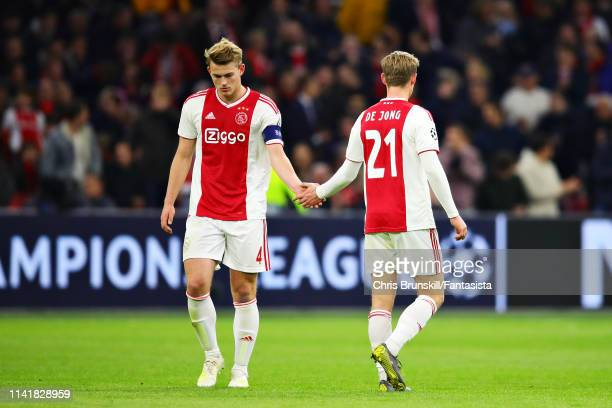Frenkie de Jong of Ajax shakes hands with teammate Matthijs de Ligt during the UEFA Champions League Quarter Final first leg match between Ajax and...