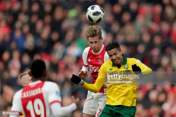 Frenkie de Jong of Ajax Tyronne Ebuehi of ADO Den Haag during the Dutch Eredivisie match between Ajax v ADO Den Haag at the Johan Cruijff Arena on...