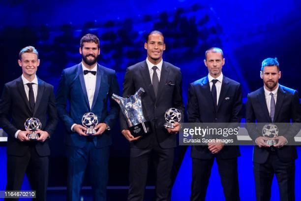 Frenkie de Jong of Barcelona Alisson Becker of Liverpool FC Virgil Van Dijk of Liverpool FC UEFA President Aleksander Ceferin and Lionel Messi of...