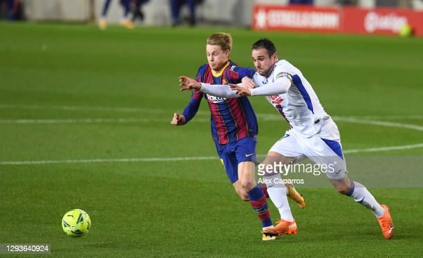 Frenkie De Jong of Barcelona and Enrique 'Kike' Garcia of SD Eibar compete for the ball during the La Liga Santander match between FC Barcelona and...