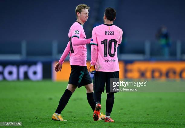 Frenkie de Jong of Barcelona and Lionel Messi of Barcelona interact during the UEFA Champions League Group G stage match between Juventus and FC...