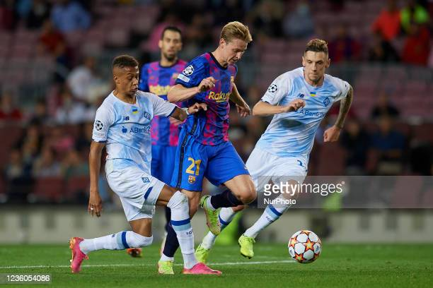 Frenkie de Jong of Barcelona and Vitinho of Dinamo Kiev compete for the ball during the UEFA Champions League group E match between FC Barcelona and...