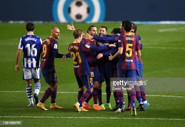 Frenkie de Jong of Barcelona celebrates after scoring their team's second goal with teammates during the La Liga Santander match between FC Barcelona...