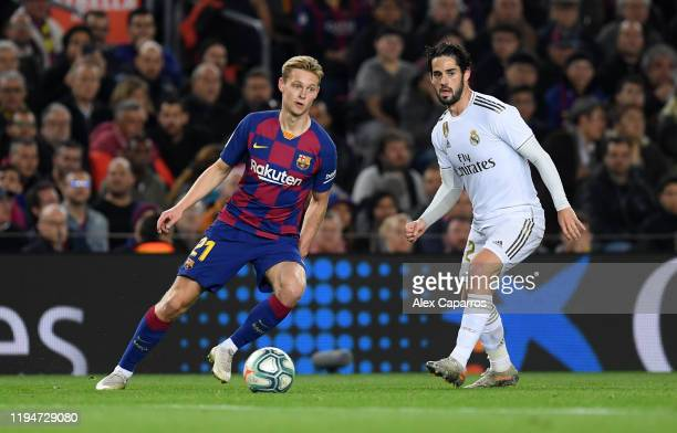 Frenkie de Jong of Barcelona holds off Francisco Alarcon 'Isco' of Real Madrid during the Liga match between FC Barcelona and Real Madrid CF at Camp...