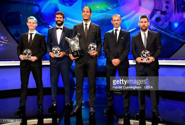 Frenkie de Jong of FC Barcelona Alisson Becker of Liverpool Virgil van Dijk of Liverpool UEFA President Aleksander Čeferin and Lionel Messi of FC...