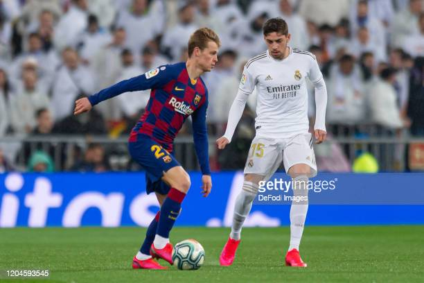 Frenkie de Jong of FC Barcelona and Federico Valverde of Real Madrid battle for the ball during the Liga match between Real Madrid CF and FC...