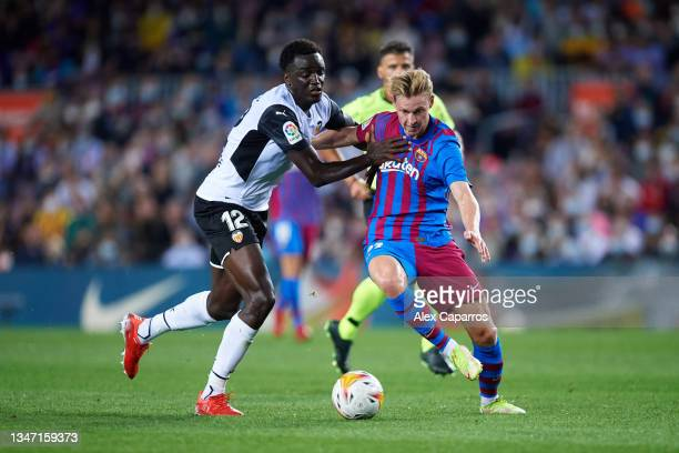 Frenkie De Jong of FC Barcelona battles for possession with Mouctar Diakhaby of Valencia CF during the LaLiga Santander match between FC Barcelona...