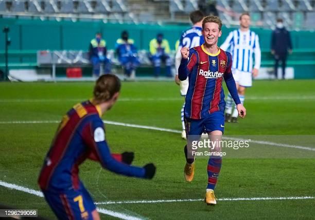 Frenkie de Jong of FC Barcelona celebrates scoring his team's opening goal with team mates during the Supercopa de Espana Semi Final match between...