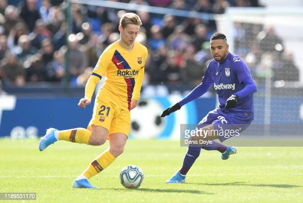 Frenkie de Jong of FC Barcelona is challenged by Yousseff EnNesyri of Leganes during the La Liga match between CD Leganes and FC Barcelona at Estadio...