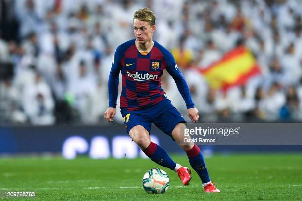 Frenkie de Jong of FC Barcelona runs with the ball during the Liga match between Real Madrid CF and FC Barcelona at Estadio Santiago Bernabeu on...