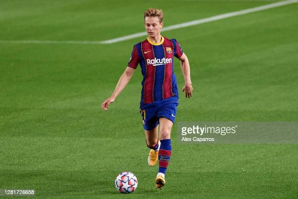Frenkie De Jong of FC Barcelona runs with the ball during the UEFA Champions League Group G stage match between FC Barcelona and Ferencvaros Budapest...