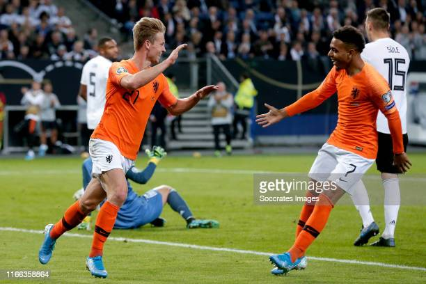 Frenkie de Jong of Holland celebrates 1-1 with Donyell Malen of Holland during the EURO Qualifier match between Germany v Holland at the Volkspark...