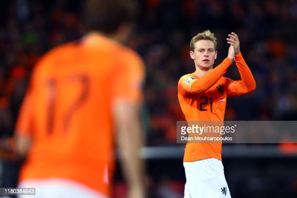 Frenkie de Jong of Netherlands applauds Daley Blind during the UEFA Euro 2020 qualifier between Netherlands and Northern Ireland on October 10, 2019...