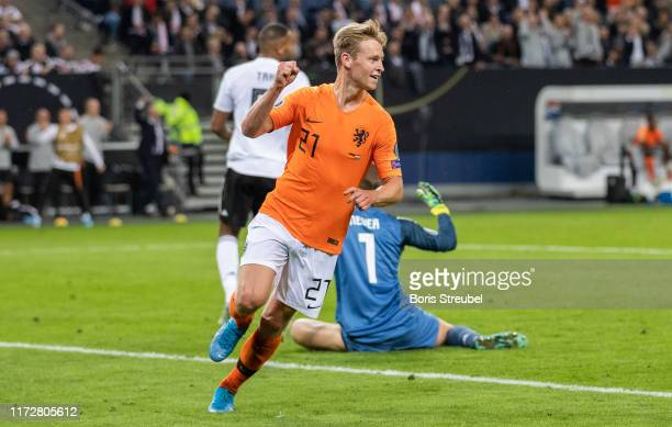 Frenkie de Jong of the Netherlands celebrates after scoring his team's first goal during the UEFA Euro 2020 qualifier match between Germany and...