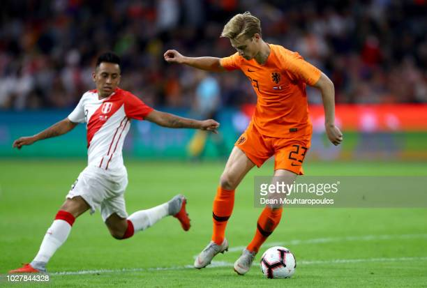 Frenkie De Jong of the Netherlands is challenged by Christian Cueva of Peru during the International Friendly match between Netherlands and Peru at...