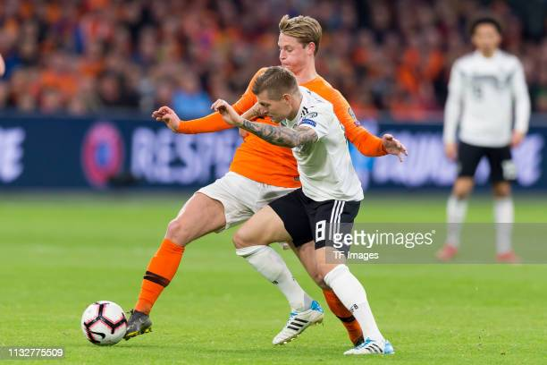 Frenkie de Jonmg of Netherlands and Toni Kroos of Germany battle for the ball during the 2020 UEFA European Championships group C qualifying match...