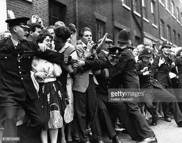 Frenzied fans await outside of St Patrick's Catholic Church for the arrival of singer Tommy Steel and Ann Donoghue to their wedding