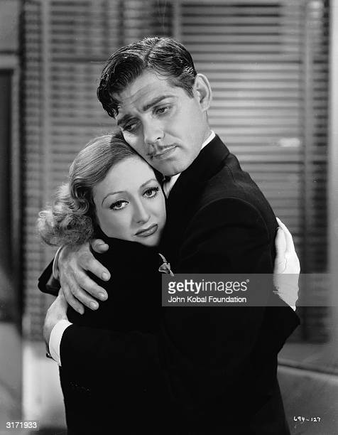 Frequent costars Joan Crawford and Clark Gable share a desperate embrace in the musical 'Dancing Lady' directed by Robert Z Leonard
