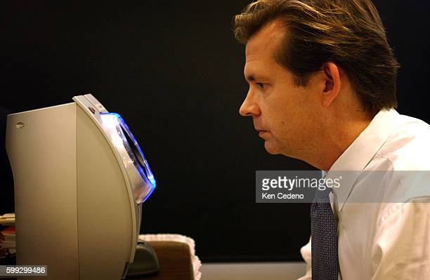 Frequent flyer Chas Harris of Washington DC has his eye scanned as he goes through the Registered Traveler Pilot Program at Ronald Reagan National...