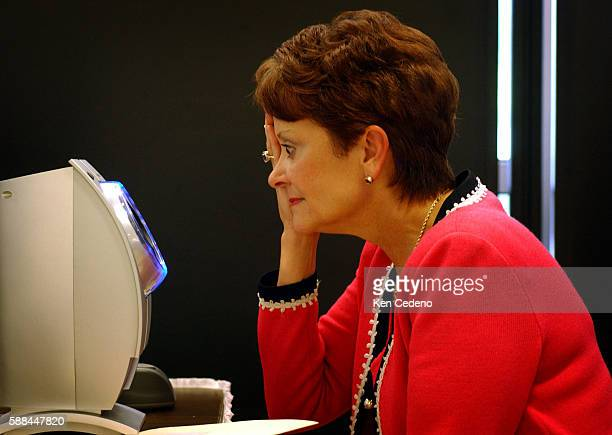 A frequent flyer has her eyes scanned during registration for the Registered Traveler Pilot Program at Ronald Reagan National Airport in Alexandria...