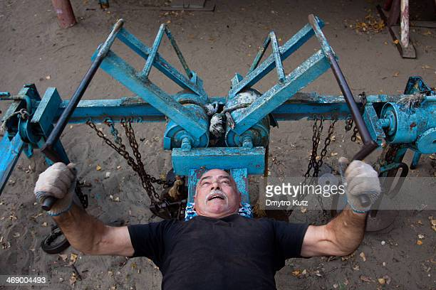 Frequenter of the open-air gym in Kiev exercising on a self-made machine.