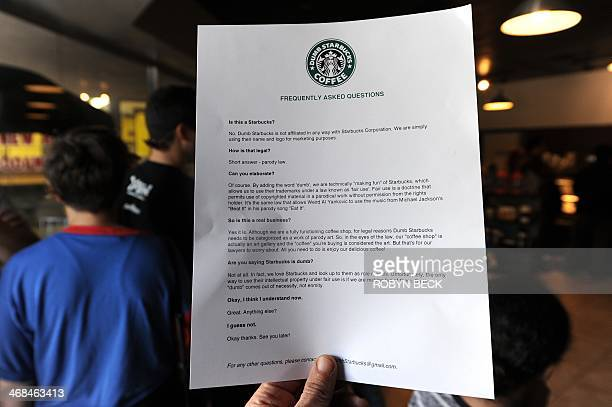 A frequently asked questions sheet is displayed inside Dumb Starbucks coffee shop February 10 in the Los Feliz area of Los Angeles CA The store...