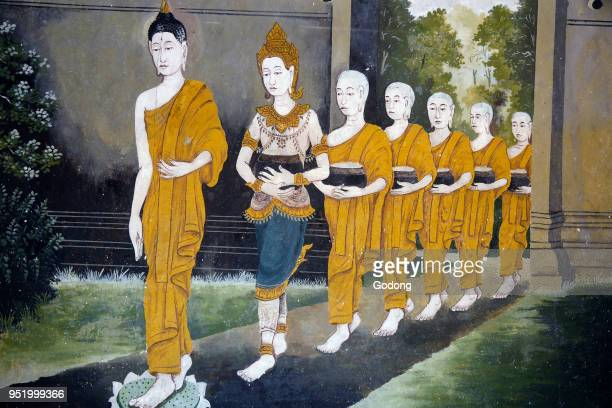 Fresco depicting a scene of the Buddha's life in Wat Phra Doi Suthep Chiang Mai Buddha and monks on an alm round Thailand