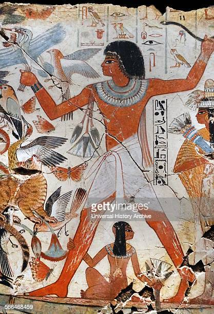 Fresco from the tomb of Nebamun shows Nebamun on a small papyrus boat with his wife Hatshepsut behind him and his son below He is about to let fly a...