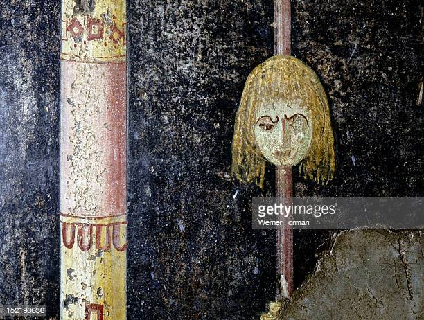 Fresco from the Villa of the Mysteries The main theme of the paintings evolve around the cult of Bacchus Detail of tragic mask Italy Roman Second...