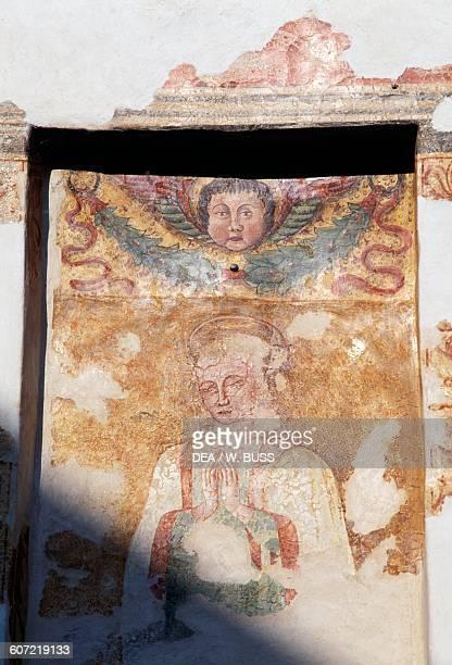 Fresco in a votive shrine, Bassano del Grappa, Veneto, Italy.