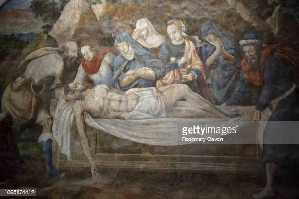 fresco of christ's body being prepared for burial. - empty tomb jesus stock pictures, royalty-free photos & images