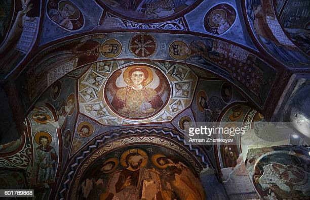 Cappadocia, Turkey - May 02, 2014: Fresco paintings depicting life of Jesus in Karanlik Kilesi (Dark Church), Goreme Open-Air Museum