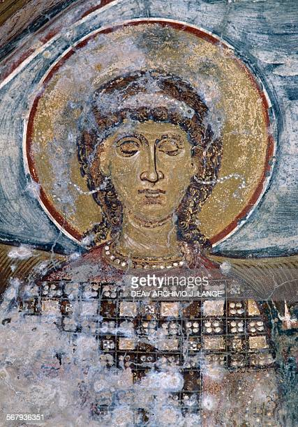 Fresco with a saint in the Byzantine church of Agios Georgios Vathi Crete Greece