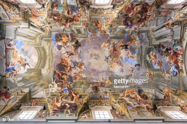 frescoed ceiling of a cathedral in rome - elysium stock photos and pictures
