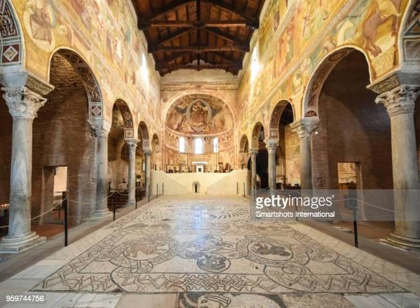 frescoes and a mosaic in a church in codigoro, emilia-romagna, italy - abbazia foto e immagini stock