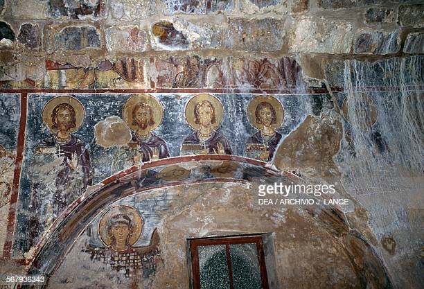 Frescoes of saints in the Byzantine church of Agios Georgios Vathi Crete Greece
