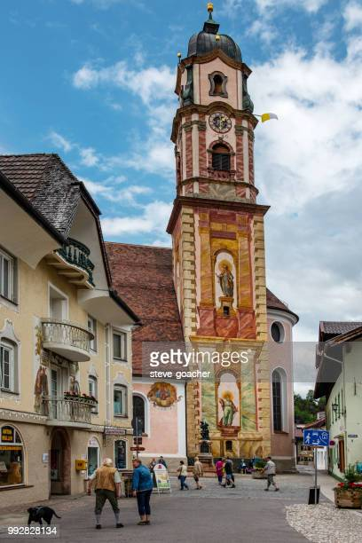 frescoes on the church of st.peter and st.paul in mittenwald, germany. - mittenwald stock pictures, royalty-free photos & images