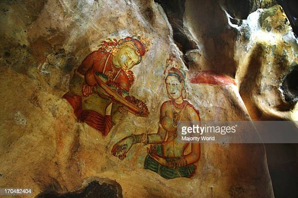 Frescos on the wall of Sigiriya rock in Matale district of Sri Lanka This 370 meter high lava mound of an ancient volcano is famous for the fortified...