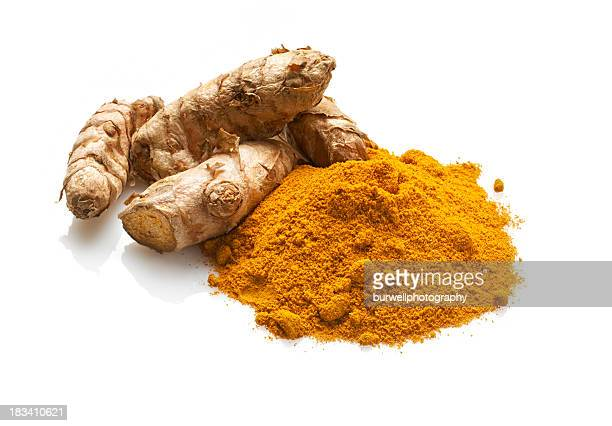 fresh and dried turmeric, isolated on white - curry powder stock photos and pictures
