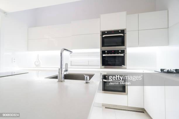 fresh and modern white style home kitchen interior - 水周り ストックフォトと画像