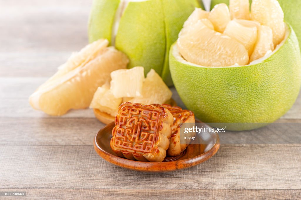 fresh and peeled pomelo(shaddock), grapefruit with slices and mooncake in mid-autumn festival(moon festival) : Stock Photo