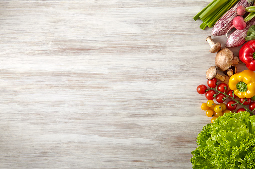 Fresh and raw vegetables on wooden kitchen table - Copy Space 1035219610