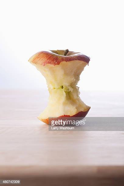 A fresh apple core on a table